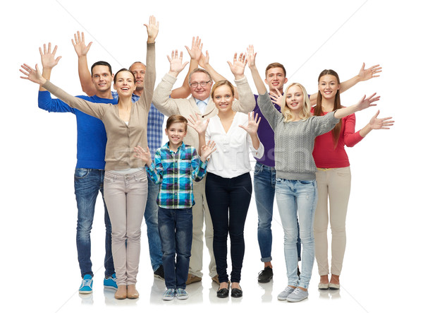 group of smiling people waving hands stock photo © Syda ...