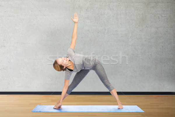 Femme yoga triangle posent fitness Photo stock © dolgachov
