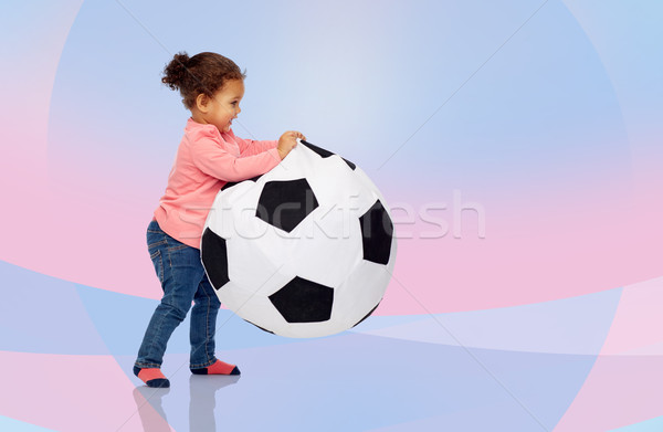 happy mulatto little baby girl playing with ball Stock photo © dolgachov