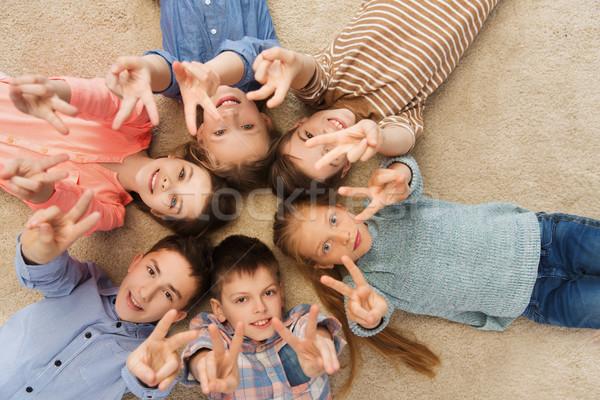 happy children showing peace hand sign Stock photo © dolgachov