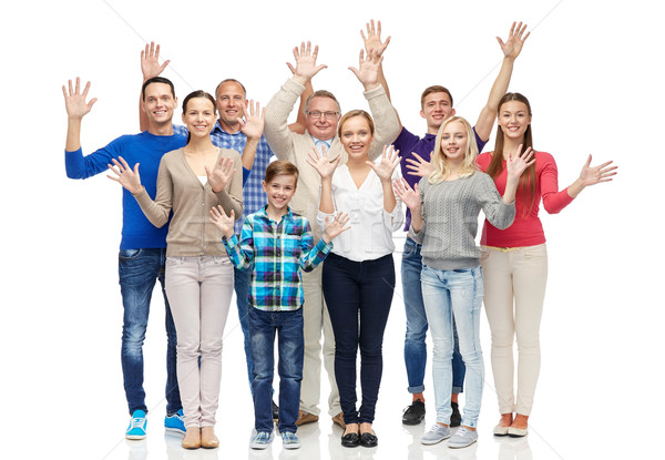 group of smiling people waving hands Stock photo © dolgachov