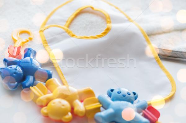 close up of baby rattle and bib for newborn Stock photo © dolgachov