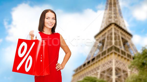 Kadın Paris Eyfel Kulesi satış indirim Stok fotoğraf © dolgachov