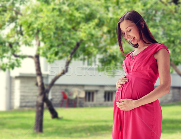 happy pregnant woman with big tummy Stock photo © dolgachov
