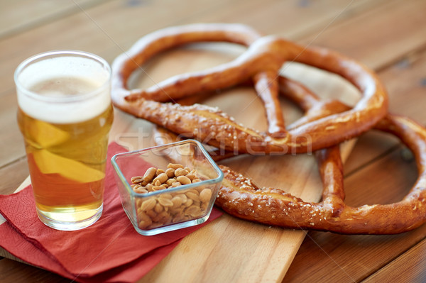 close up of beer, pretzels and peanuts on table Stock photo © dolgachov