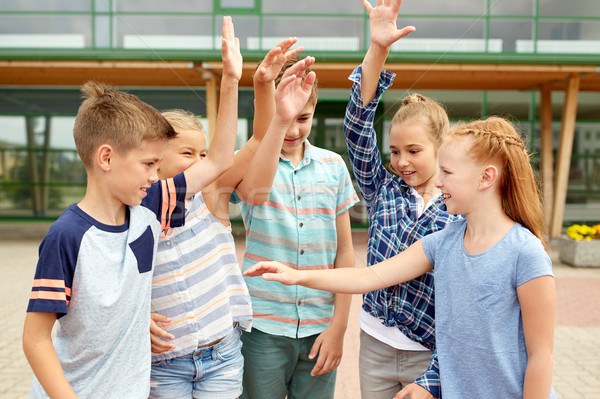 group of happy elementary school students Stock photo © dolgachov