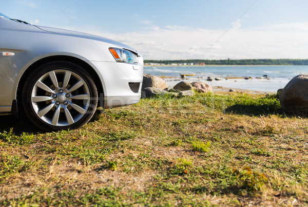 close up of car parked on sea shore or beach Stock photo © dolgachov