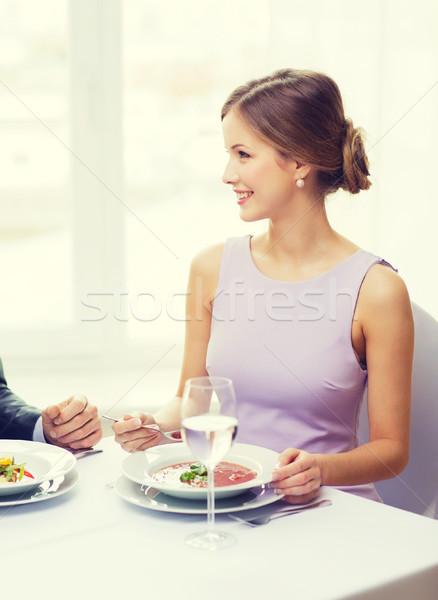 Genç kadın bakıyor koca erkek arkadaş restoran çift Stok fotoğraf © dolgachov
