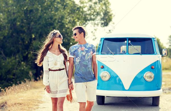 smiling young hippie couple over minivan car Stock photo © dolgachov