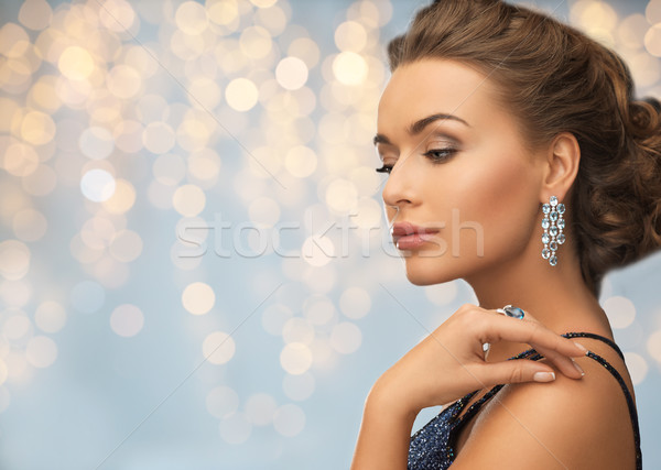 woman in evening dress with diamond earring Stock photo © dolgachov