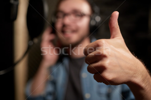 singer showing thumbs up at sound recording studio Stock photo © dolgachov