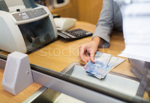 clerk with swiss francs cash money at bank office Stock photo © dolgachov