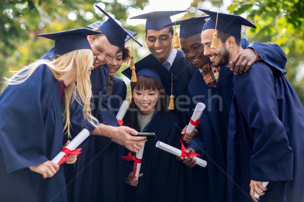 Stock photo: students or bachelors with diplomas and smartphone