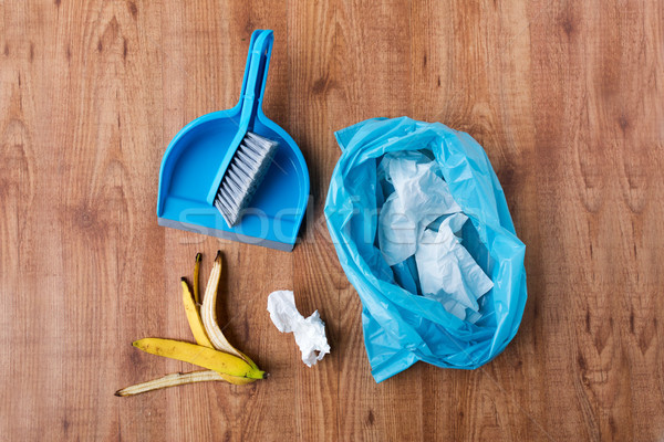 rubbish bag with trash and cleaning items at home Stock photo © dolgachov