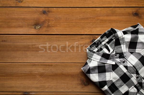 Közelkép kockás póló fából készült szennyes ruházat Stock fotó © dolgachov