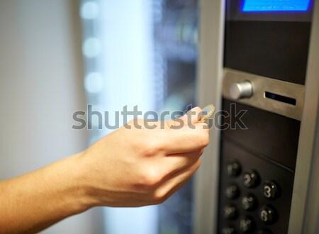 hand inserting euro coin to vending machine Stock photo © dolgachov