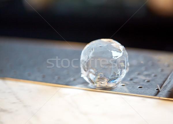 hand-cut ice ball at bar Stock photo © dolgachov