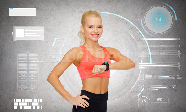 happy sporty young woman with fitness tracker Stock photo © dolgachov