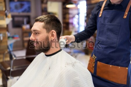 barber showing hair styling spray to male customer Stock photo © dolgachov