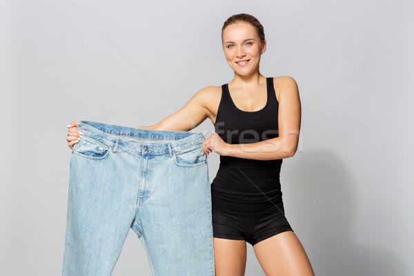 Fiatal karcsú sportos nő nadrág diéta Stock fotó © dolgachov