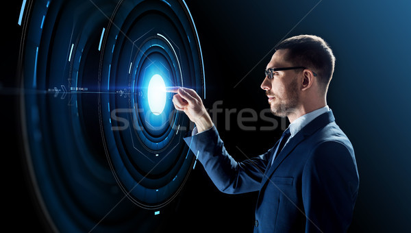 businessman in glasses with virtual projection Stock photo © dolgachov