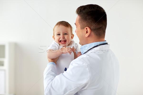 Mutlu doktor çocuk doktoru bebek klinik tıp Stok fotoğraf © dolgachov