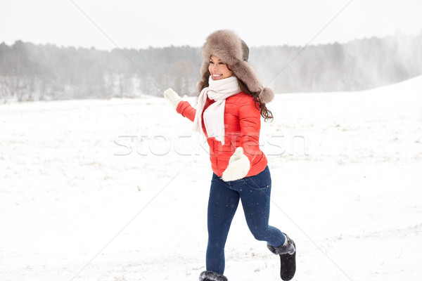 happy woman in winter fur hat having fun outdoors Stock photo © dolgachov
