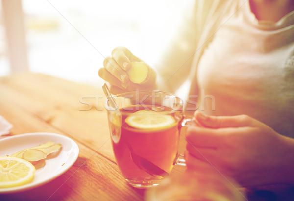 Közelkép nő gyömbér tea citrom egészség Stock fotó © dolgachov