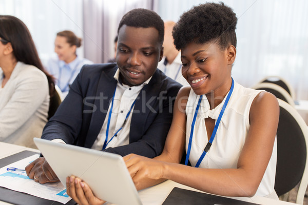 Stock photo: team with tablet pc at business conference