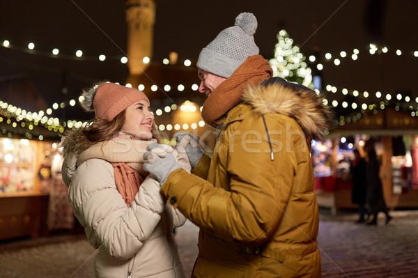 happy couple holding hands at christmas market Stock photo © dolgachov