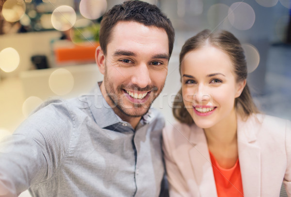 happy couple taking selfie in mall or office Stock photo © dolgachov