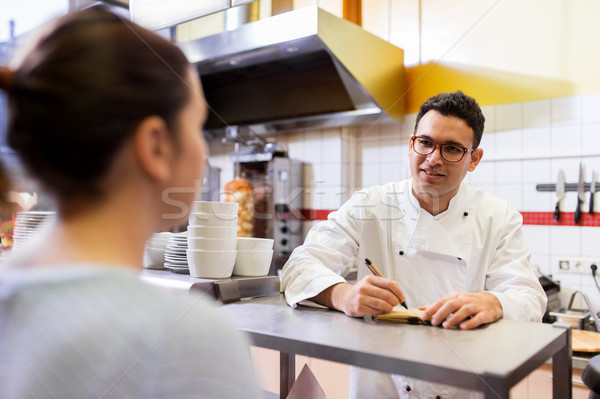 Stock photo: chef at fast food restaurant writing order