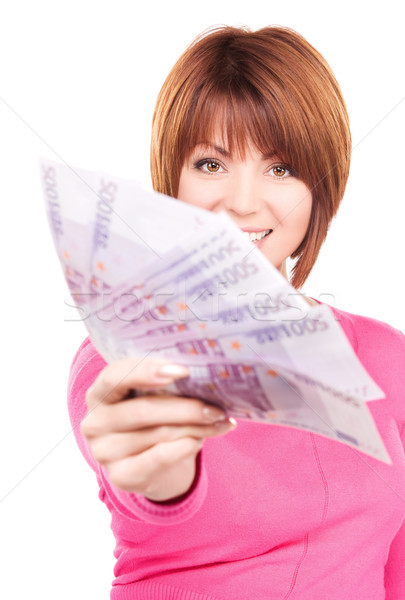 Stock photo: happy woman with money