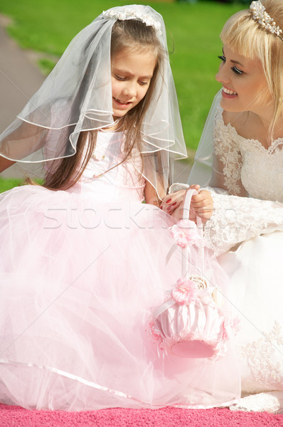 happy bride and little bridesmaid Stock photo © dolgachov