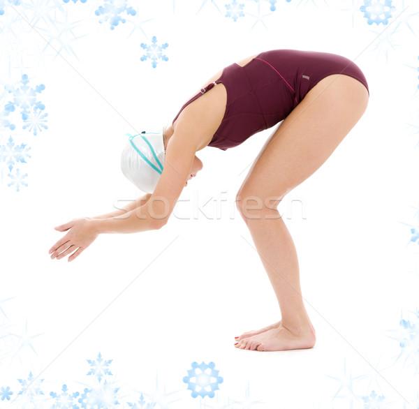 Pływak jasne zdjęcie kobieta płatki śniegu dziewczyna Zdjęcia stock © dolgachov