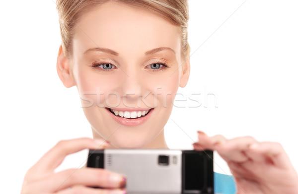 счастливым женщину телефон камеры фотография лице Сток-фото © dolgachov