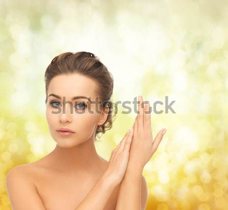 woman holding branch with thorns Stock photo © dolgachov