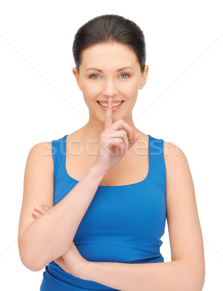 woman making a hush gesture Stock photo © dolgachov
