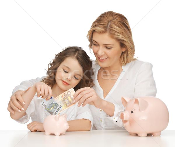 Anya lánygyermek malac bankok papír pénz Stock fotó © dolgachov