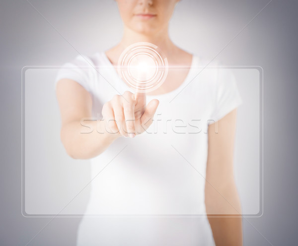 woman hand touching virtual screen Stock photo © dolgachov