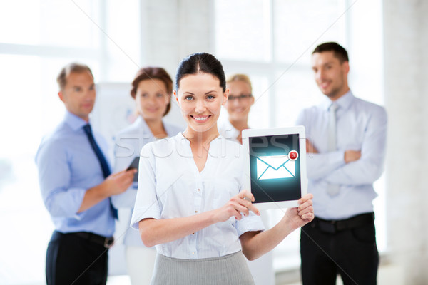 businesswoman holding tablet pc with email sign Stock photo © dolgachov
