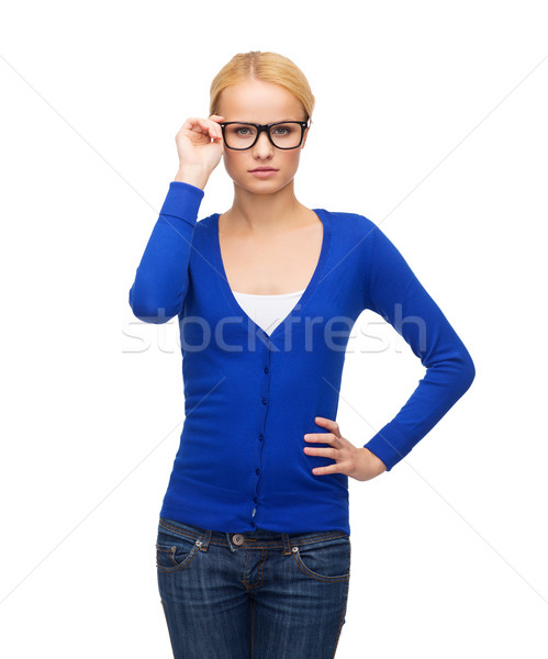 smiling woman in casual clothes wearing eyeglasses Stock photo © dolgachov
