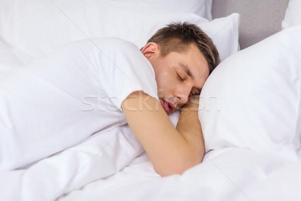 красивый мужчина спальный кровать отель путешествия счастье Сток-фото © dolgachov