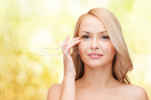 Bela mulher tocante olho beleza cara mulher Foto stock © dolgachov