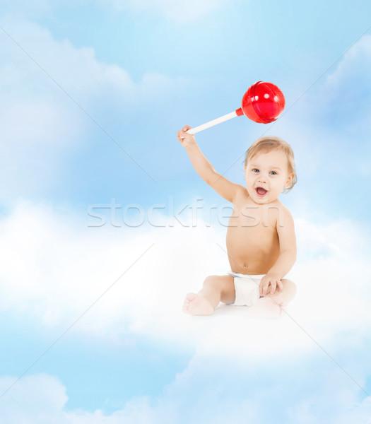 Cute piccolo ragazzo giocare grande lollipop Foto d'archivio © dolgachov