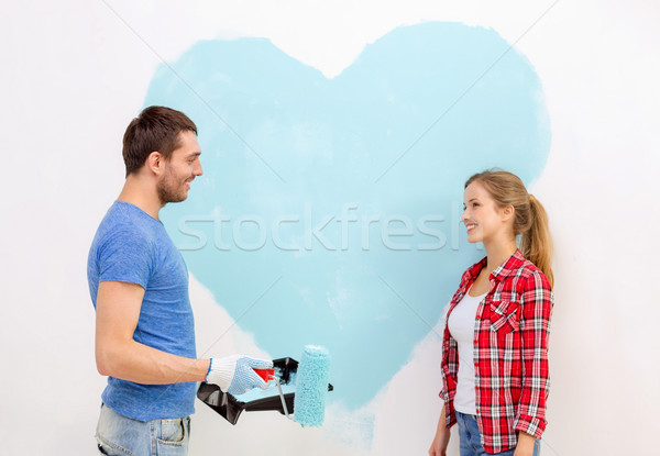 Stockfoto: Glimlachend · paar · schilderij · groot · hart · muur