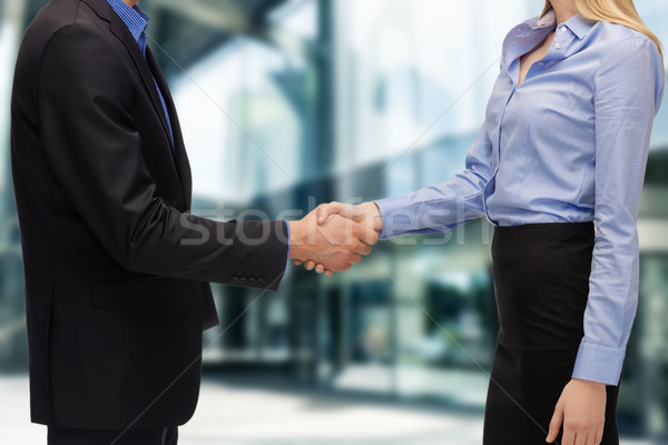 Empresario mujer de negocios apretón de manos negocios oficina aire libre Foto stock © dolgachov