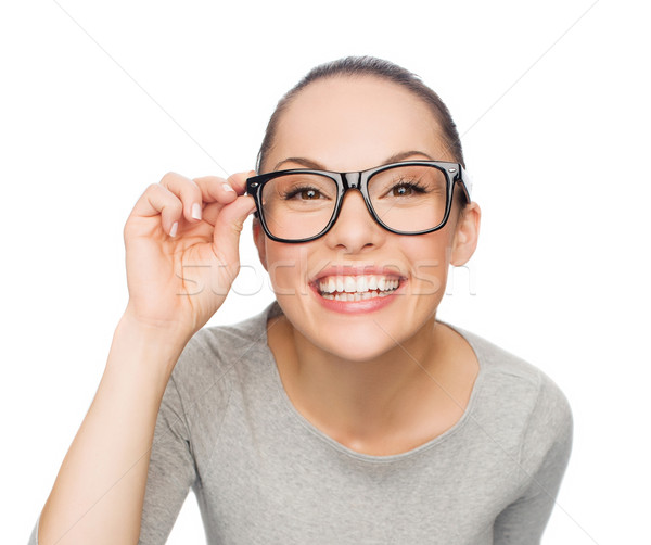 asian woman in adjusting eyeglasses Stock photo © dolgachov