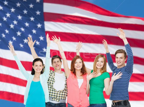 Grupo sonriendo estudiantes manos educación Foto stock © dolgachov