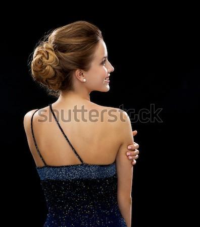 Mujer sonriente vestido de noche atrás personas vacaciones glamour Foto stock © dolgachov